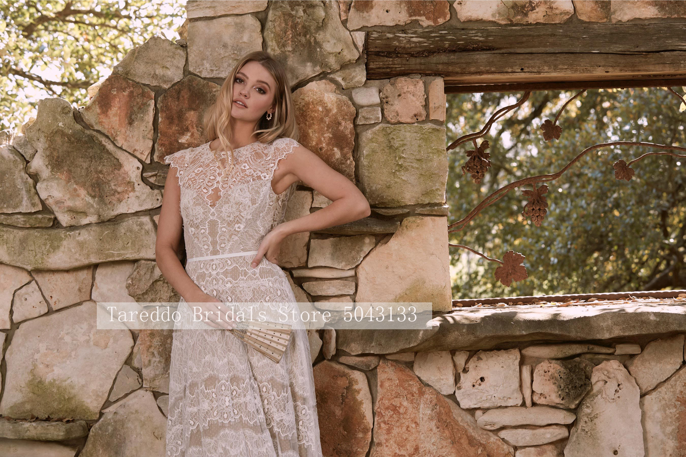Lace Bohemian Wedding Dresses Sexy Sheer O neck Open Back A Line Sweep Train Bridal Wedding Gowns with Tiered Skirt 2021