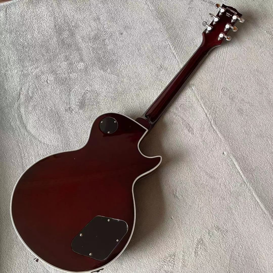 Left hand Custom Electric Guitar.Sunburst tiger flame top.Tune-o-Matic bridge.Mahogany body.High quality 6 stings guitarra. enlarge