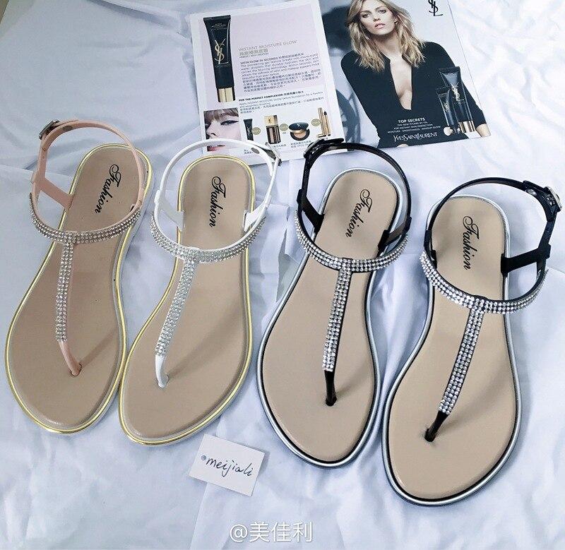 Nuevas sandalias planas para mujer, zapatos casuales a la moda tipo T con Clip ostentoso, Tanga para damas con hebilla para la playa, zapatos de verano para mujer A198