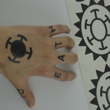 Anime chaud une pièce autocollant Trafalgar loi Cosplay tatouage Trafalgar D eau loi Logo Tatoo