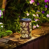 creative outdoor solar lantern light hanging solar metal leaf projection lamp garden lamp for patio outside or table lamp