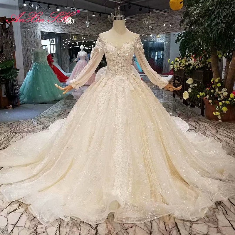 AnXin SH الفاخرة الأميرة زهرة الدانتيل الأبيض الخرز الكريستال س الرقبة سباركلي كم طويل القوس الكبير فستان الزفاف 100% صور حقيقية