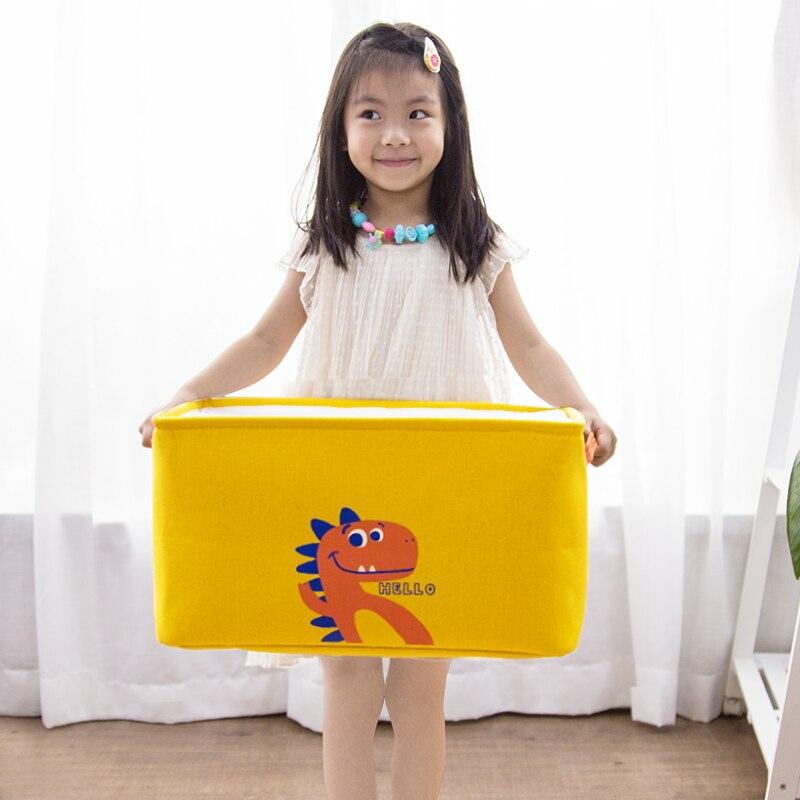 2019 nuevo diseño de dinosaurio de dibujos animados contenedor de almacenamiento de juguete para niños cesta con cordón