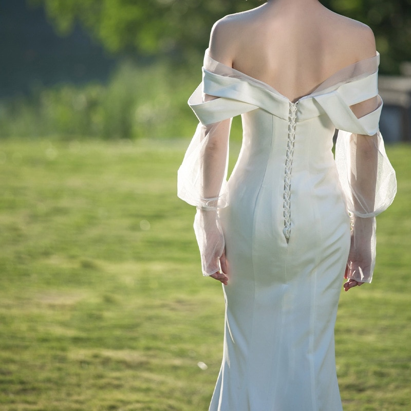 luxury design simple foreign style fashion long sleeved white dress temperament sexy slim straight neck tail light wedding dress