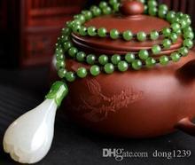 Collier pendentif Magnolia en Jades blanc naturel 100% néphrite sculpté à la main