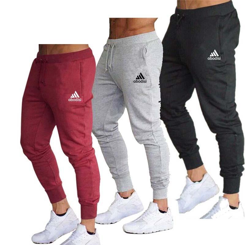 aliexpress.com - Men's casual sports pants, sportswear, tights, black, jogging, zipper pants, tights, casual pants 2021 NEW