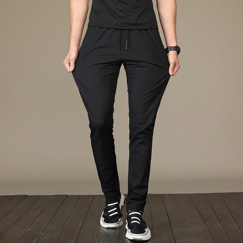 Pants men's Korean 2020 summer thin casual pants breathable loose men's pants ultra thin quick drying sports pants