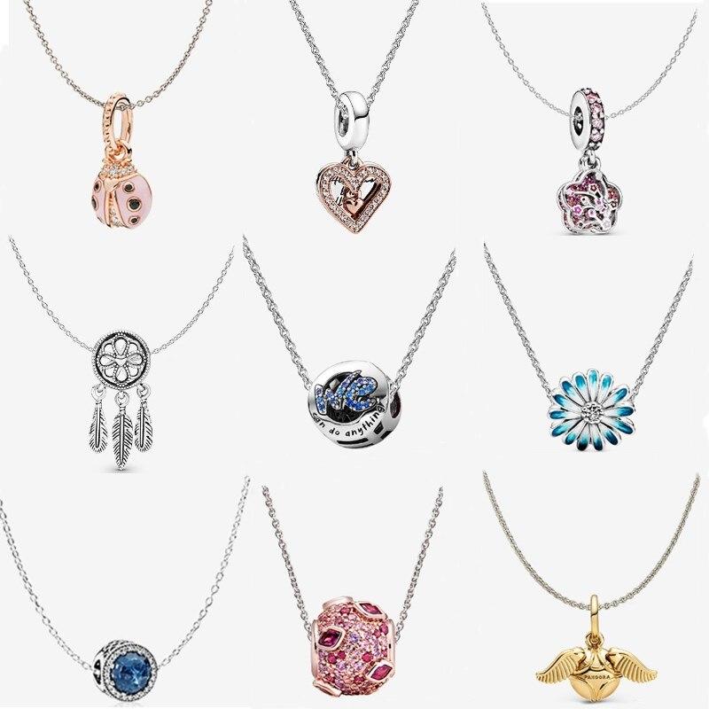 Collar Couqcy de Color plateado, cadena colgante de serpiente, Ángel, perro, copo de nieve, estrella, Luna, dijes originales para mujer