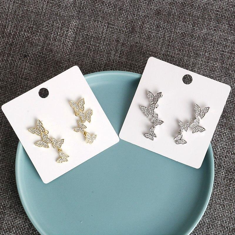 Pendientes de mariposa de cristal para mujer, aretes pequeños de tuerca coreanos...