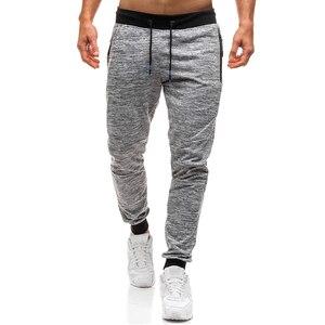 Men's sports pants Male overalls lanyard mid waist pants mens fashionable casual school pants Joggers Pants Solid Color Pants