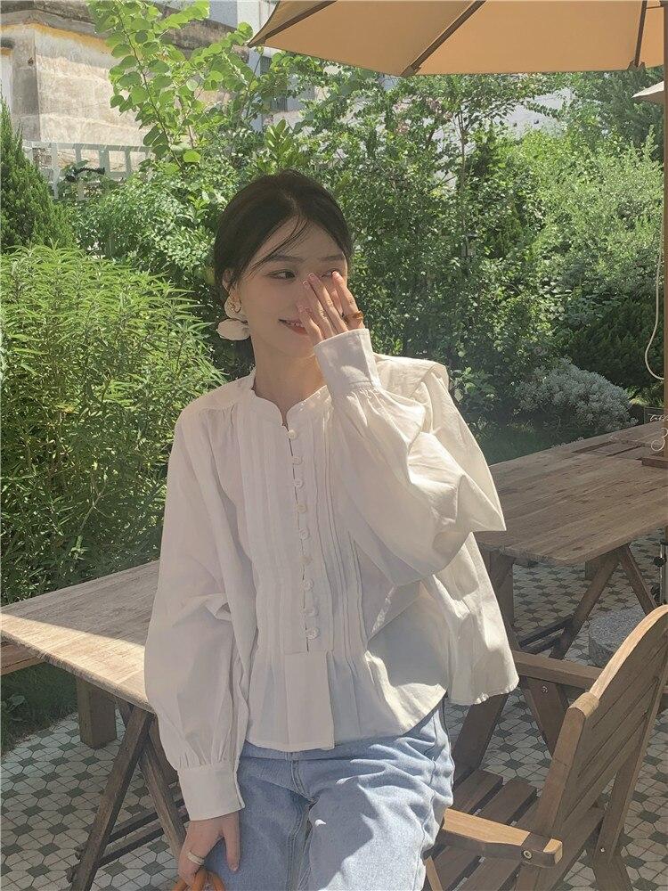 Temperament White Shirt Round Neck Long Sleeve Female Design Sense Of Minority Early Autumn 2021 New
