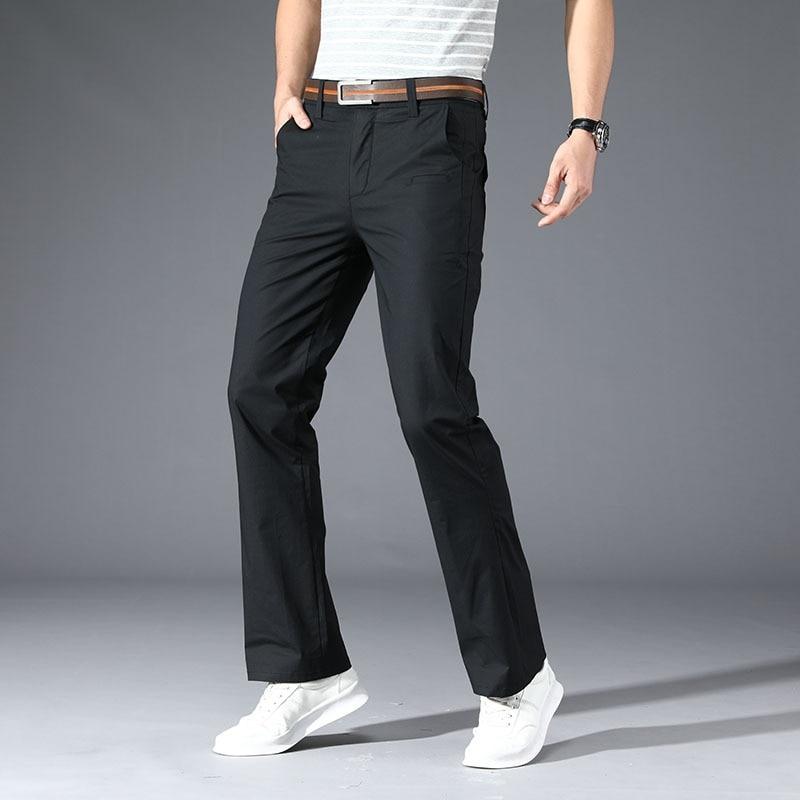 Однотонные повседневные мужские длинные брюки, Осенние белые мужские брюки на молнии с карманами, облегающие эластичные корейские деловые ...