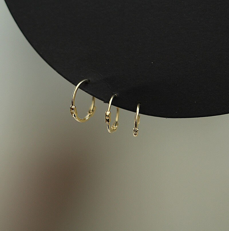 9k/14k puro ouro brinco simples moda ultra-fino suave mini redondo orelha anel osso orelha fivela selvagem mulher menina ouro orelha jóia