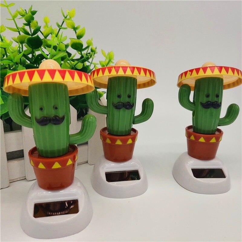1Pcs Bonito Criativo Cactus Verde com Chapéu Crianças Bonecas Brinquedos de Entretenimento Balanço Automático Solar Brinquedos Automóvel Decoração Suprimentos