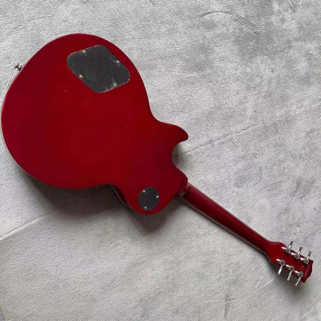 Custom shop.Electric Guitar.Ebony fingerboard.Red color tiger flame maple top gitaar.Mahogany body. enlarge