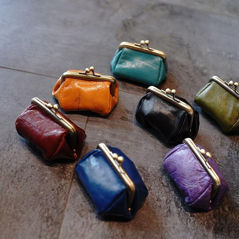 Mini bolsas Unisex de cerrojo monedero de cuero de vaca genuino para auriculares Retro, bolsos de Metal hechos a mano, bolsas pequeñas bonitas para mujeres, regalo