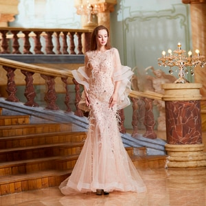2021 Fashion Mermaid Evening Dresses Jewel Long Sleeves Lace Appliques Feather Prom Gowns Custom Made Sweep Train Party Dress