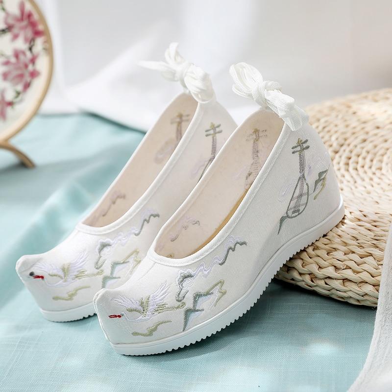 سبعة سم في ارتفاع 7 سنتيمتر الرياح القديمة الأحذية هان القماش الأحذية القوس الأحذية المطرزة الأحذية القماش الأحذية