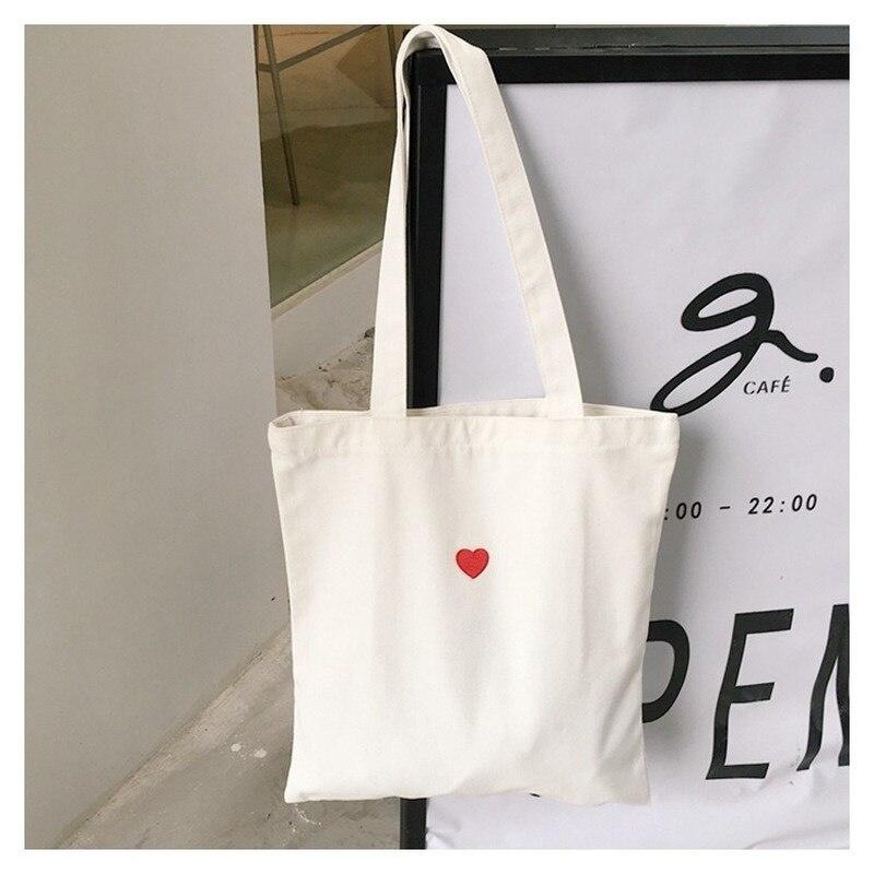 Bolso de mano de lona para mujer de bolsa de la compra de tela plegable ecológica de algodón color blanco corazones rojo para
