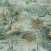 Tissu en tulle vert menthe brodé   Maille, dentelle, pour robe couture, tela telas ou metro