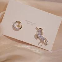 high quality 14k real gold xingyue unicorn asymmetrical design temperament stud earrings for women cubic zircon zc earrings
