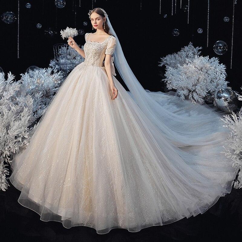 رداء دي ماريج الأميرة فستان الزفاف الترتر Vestido De Novia قصيرة الأكمام الفاخرة القوس الكبير ستار غزل الكرة ثوب فساتين الزفاف