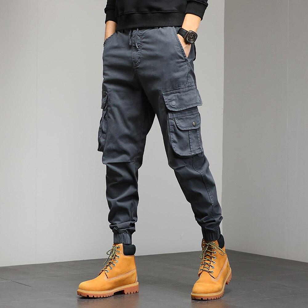 السراويل البضائع Masculino الرجال سروال التدريب جيوب متعددة في الهواء الطلق السراويل التكتيكية Sweatpants الرجال