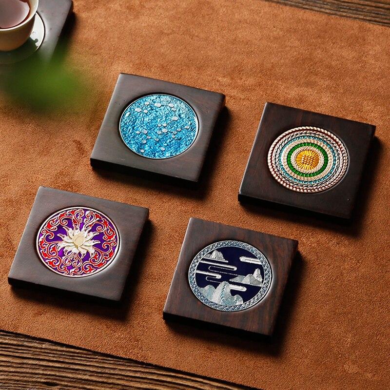 Posavasos de ébano de madera maciza juego de té Kung Fu accesorios de Ceremonia de té estera de aislamiento olla de hierro de estilo japonés olla de arena púrpura titular de la