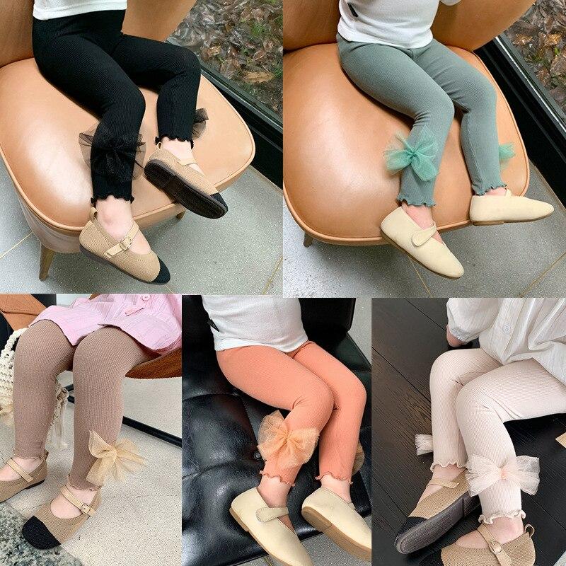 Leggings de niña primavera y otoño nuevo estilo coreano ropa interior con lazo de oruga ropa exterior niñas pantalones gruesos