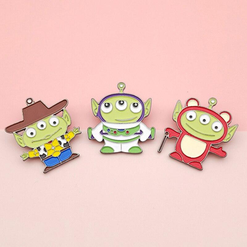 Broche de alien de tres ojos, dibujo animado, versión coreana, hebilla en el pecho, bolsa, zapatos, accesorios, joyería esmaltada, pequeña insignia