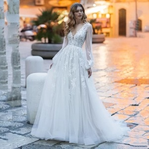 A-Line Puffy Long Sleeve Wedding Dresses 2021 V-Neck Lace Appliques Elegant Tulle Bridal Gown With Button Back Sweep Train