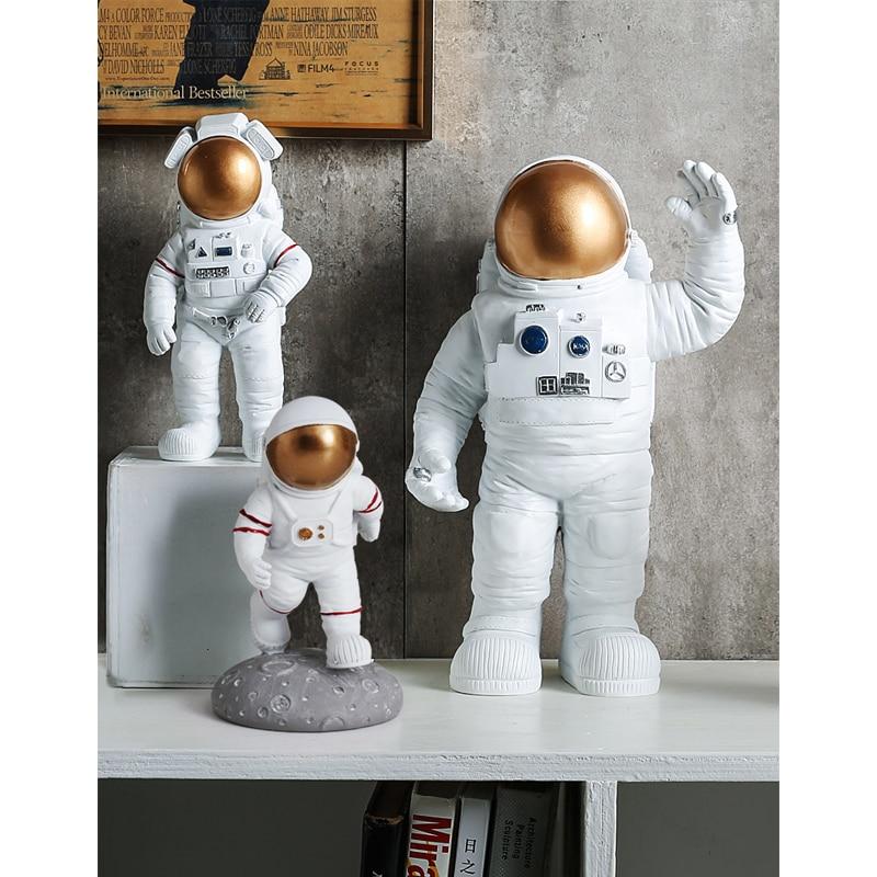 Moderno y creativo espacio exterior astronautas escultura en miniatura resina modelos de Luna estatuilla cosmonáutica artesanías ornamento decoración del hogar