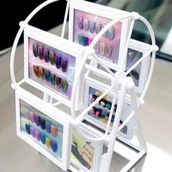 Moda unha polonês rotativa moinho de vento expositor prateleira design cor placa de exibição cartão gráfico do livro