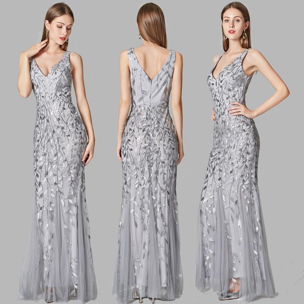 فساتين سهرة أنيقة باللون الفضي والرمادي لعام 2021 فستان مثير بياقة على شكل حرف V مفتوح من الخلف بدون أكمام مطرز بخرز وذيل السمكة