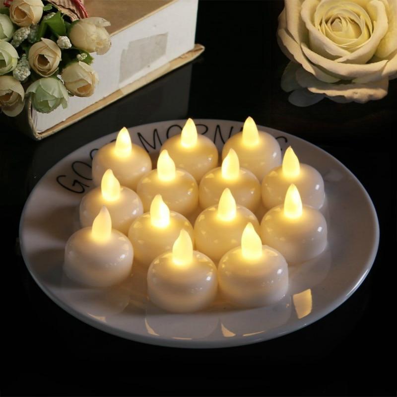 24 piezas lámpara de vela impermeable sin llama flotador en agua Led de plástico flotante té luces de decoración de fiesta con pilas
