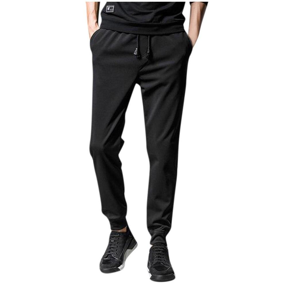 Pantalones deportivos para correr para hombre, pantalones sueltos con bolsillos, entrenamiento elástico,...