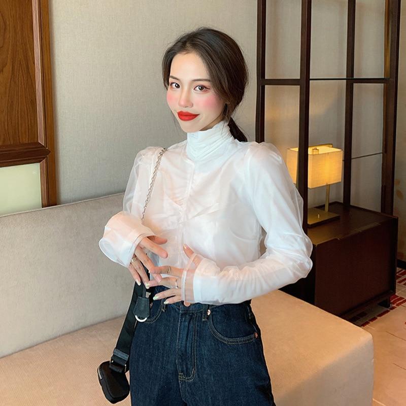 Camisa a la moda con mangas abombadas, Tops para mujer, Otoño e Invierno 2019, nuevo estilo, estilo coreano, corte entallado, cuello alto, camiseta de manga larga