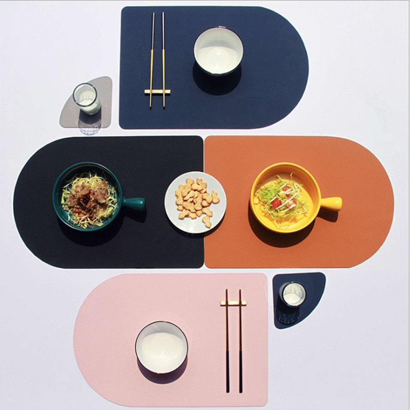 Un conjunto de estilo nórdico hogar cuero manteles individuales occidentales aislante e impermeable de mesa esteras creativo manteles mantel