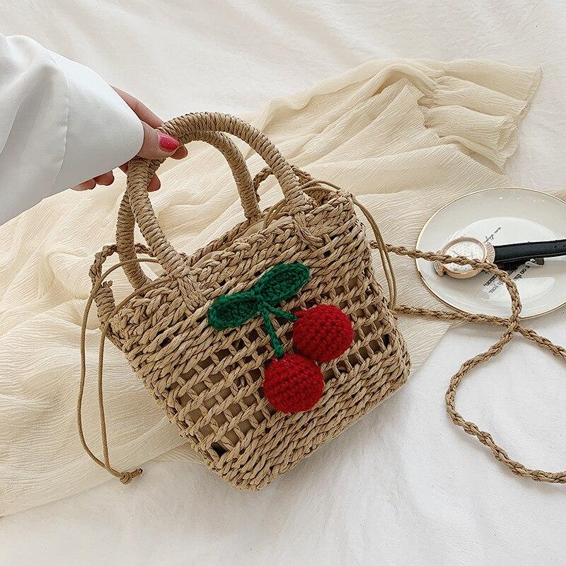 2020 nueva tendencia de verano personalidad cereza bolsa de compras de paja mujeres salvajes vacaciones en la playa bolsas de mensajero de hombro bolso de playa