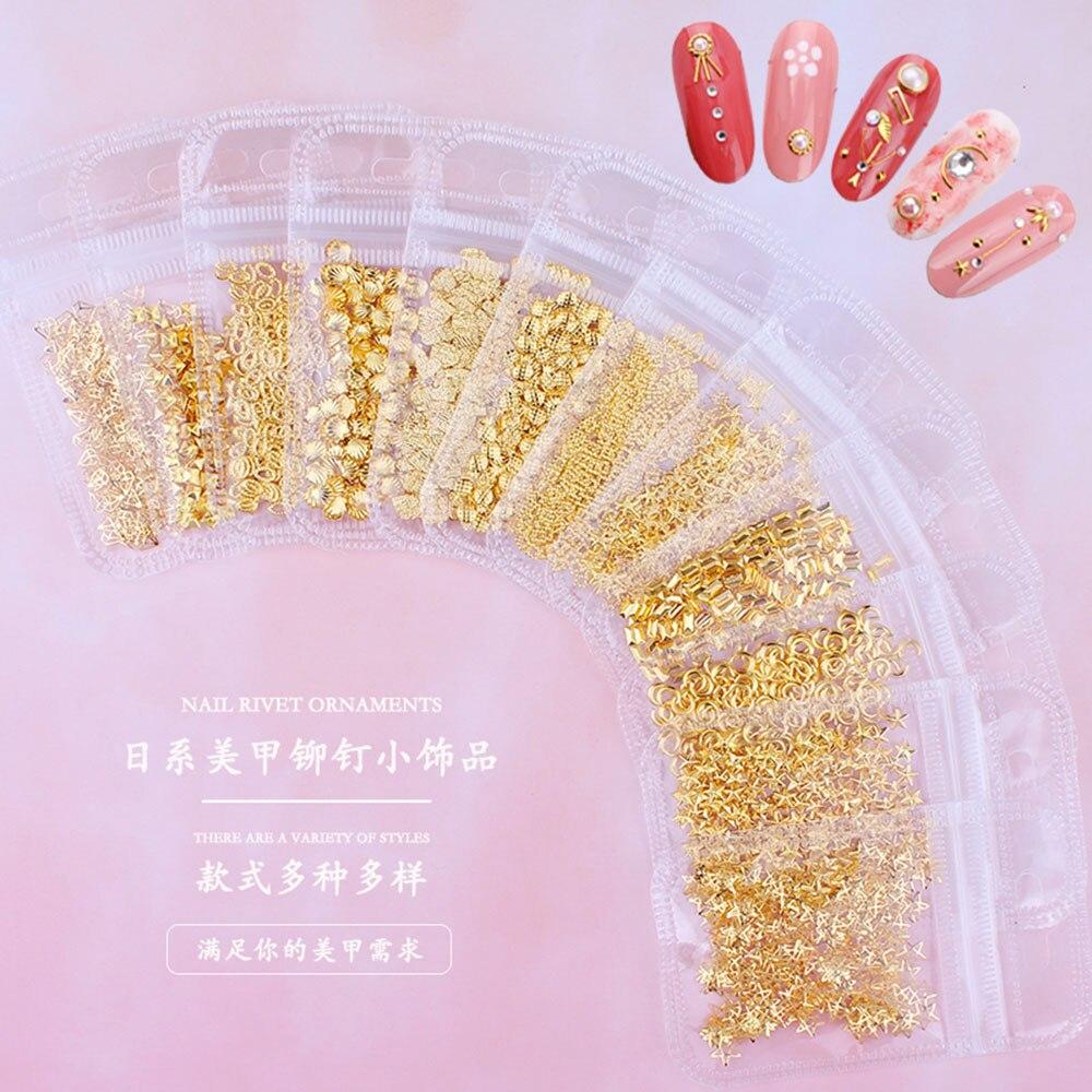 Купить с кэшбэком 1Bag Mixed Shaped 3D DIY Hollow Metal Frame Nail Art Decorations 200pcs Gold Rivet Manicure Accessories Nail Glitter Studs JS08