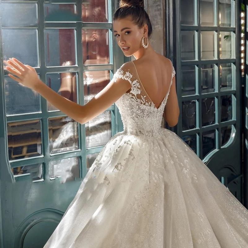Luxury Wedding Dresses Sleeveless O-Neck Lace Applique Sweetheart Gowns Sexy Backles Shiny Tulle vestido de noiva  50cm Train