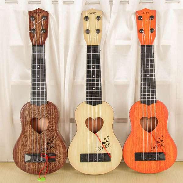 Instrumento Musical mini ukelele guitarra para niños juguete creativo juego escolar color aleatorio