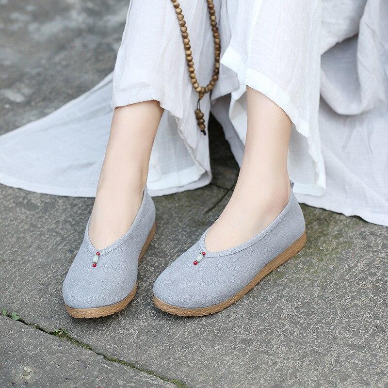 الربيع والخريف جديد نمط العرقية الرياح القماش أحذية القدم دواسة القديمة نمط مسطحة القاع مطابقة الأحذية أحذية القماش بقعة
