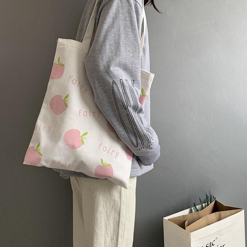 Bolso de compras de lona de estilo Casual para mujer, bolso de hombro de tela de Hada de manzana, bolso de algodón para chicas estudiantes, bolso reutilizable para comprador ecológico para mujer
