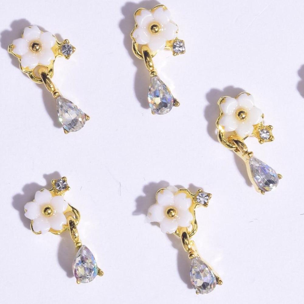 Купить с кэшбэком 10Pcs/Lot 3D Alloy Nail Art Rhinestones Flower Design Pearl With Crystal Studs Supplies Decorations DIY Manicure Tools Accessory