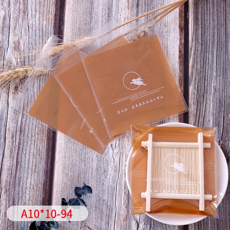 50 unids/lote, bolsa autoadhesiva de celofán esmerilado transparente dorado, bolsa autoadhesiva de conejo saltador, paquete de suministros de galletas de jabón para panadería casera