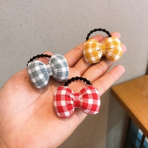 Free shipping lattice bow Children's hairties BB girl's rubber band kid's hair bands Ponytail Holder Hair accessories