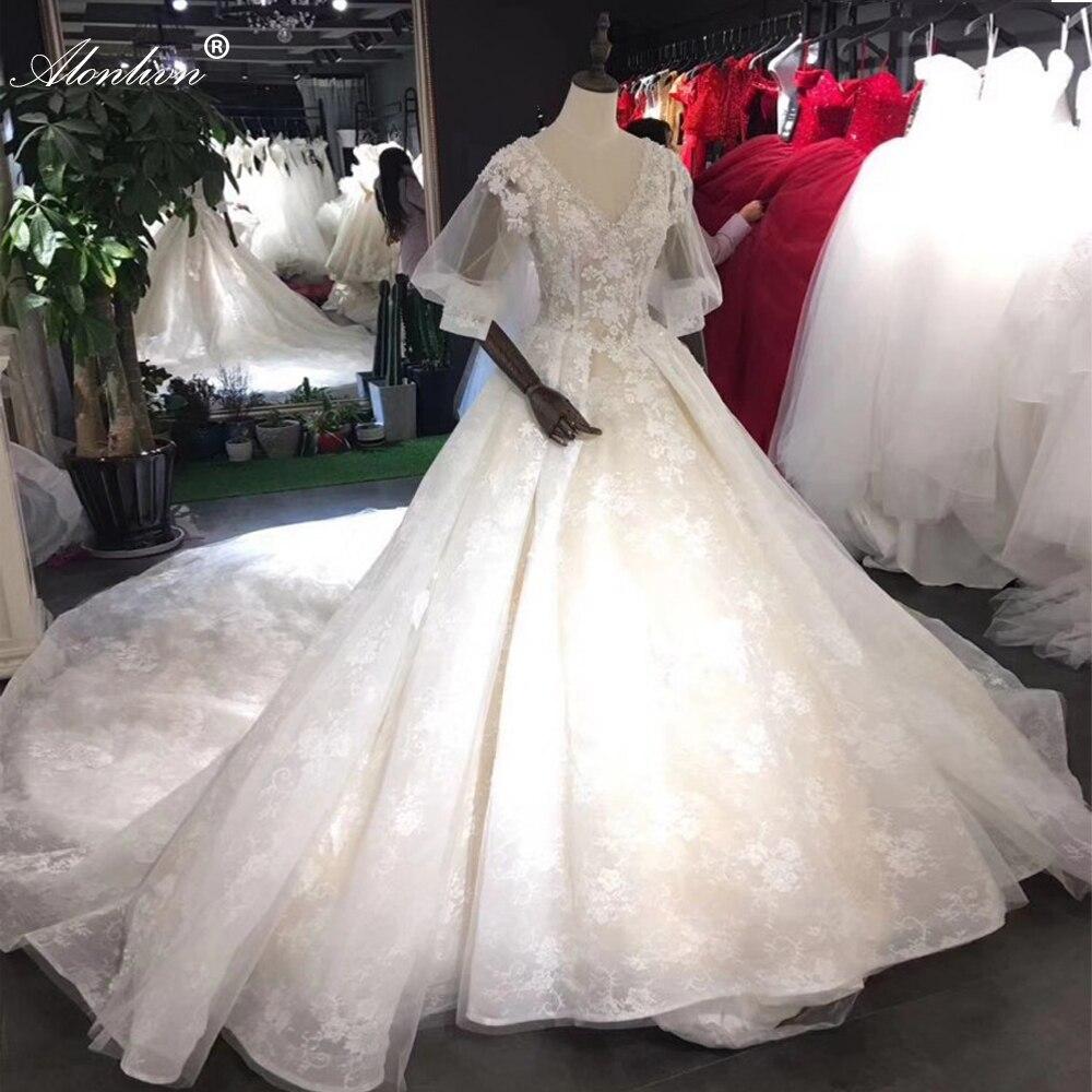 Alonlivn ثوب الزفاف الكرة الفاخرة مع خط العنق الخامس من الدانتيل رائع حتى التنانير الزفاف مخصص
