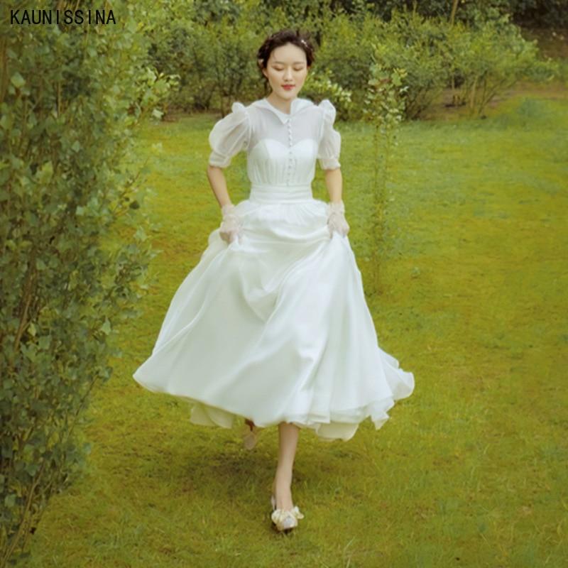 KAUNISSINA فساتين زفاف الشاطئ بسيطة أنيقة تول زر العروس ثوب نصف نفخة الأكمام بوهو الأميرة فستان حفلات الزفاف