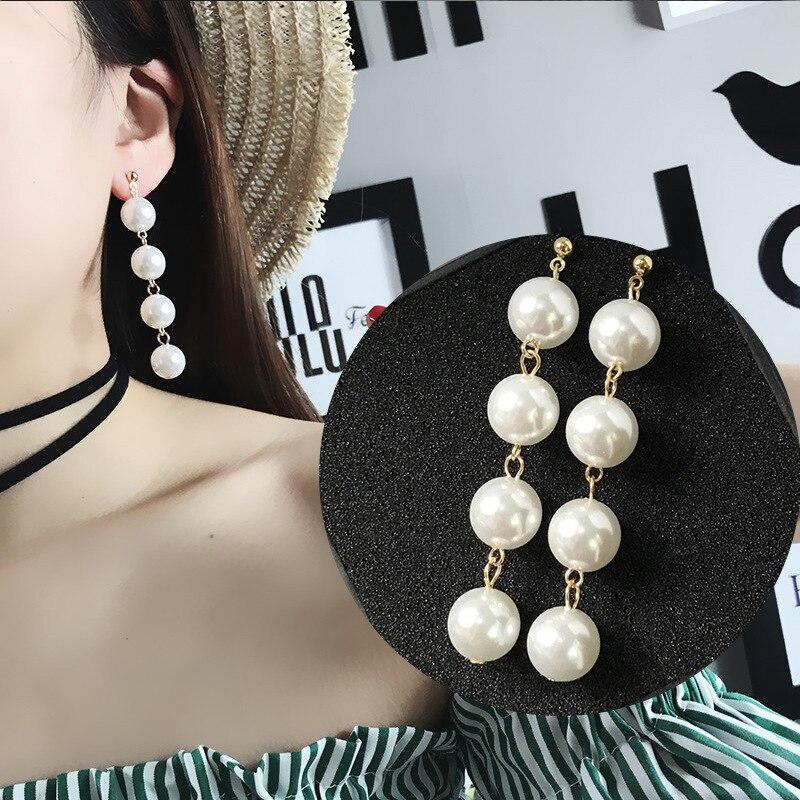 Aretes Japón y Corea del Sur Joker contrajo temperamento exagerada perlas con borlas pendientes largos fabricantes venta